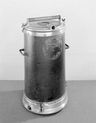 Canister-type vacuum cleaner, c 1910-1914.