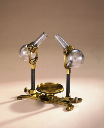 Bras stand with two tilting glas flasks, 1761.