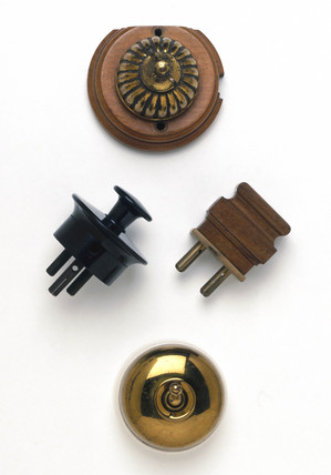 Two switches and two plugs, c 1920s.