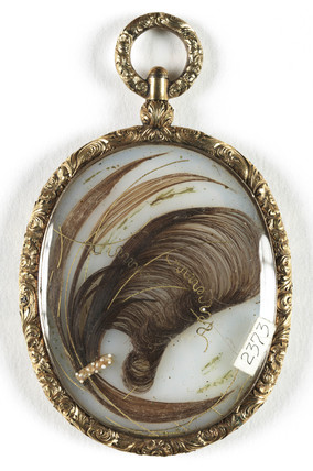 Pendant containing a lock of hair, c 1850