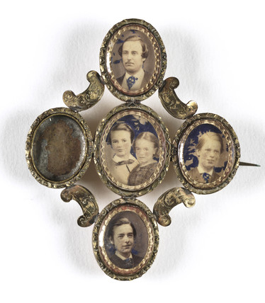 Family photographs in an elaborate frame, mid-late 19th century.