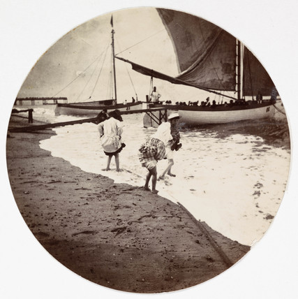 Children paddling in the sea, c 1890.