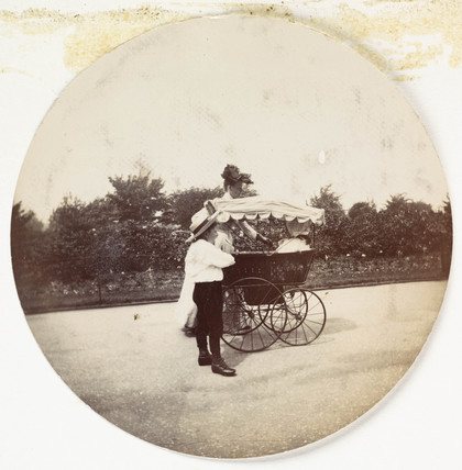 Woman, boy and a pram, c 1890.