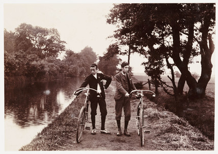 Cyclists on a towpath, c 1900.