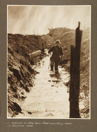 A flooded trench, c 1917.