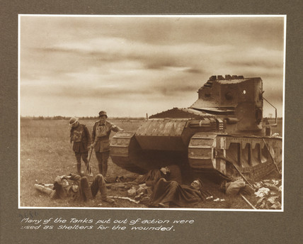 Tank and wounded soldiers, c 1917.