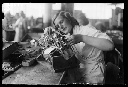 Woman working on the asembly line at the HMV works, Hayes, 8 August 1932.