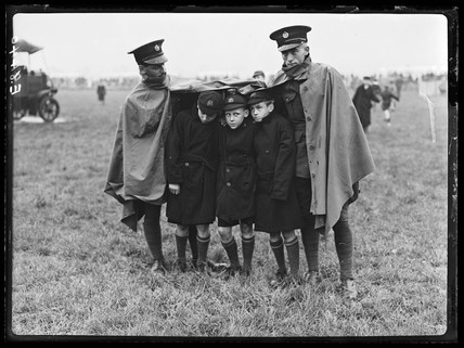 Schoolboys in the rain at an RAF pageant, 1936.