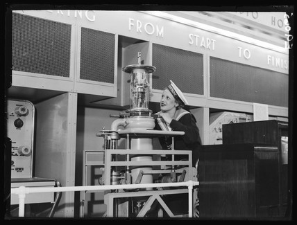 Woman with Marconi transmitting valve, Radiolympia, London, 1936.