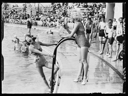 Water fight at an outdoor swimming pool, 1937.