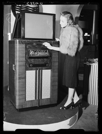 Woman demonstrating a television receiver, Radiolympia, London, 1938.