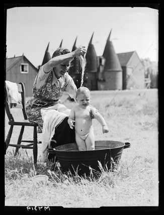 Bathing the baby, 15 August 1944.