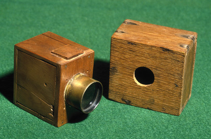 Two of W H F Talbot's experimental 'mousetrap' cameras, c 1835.