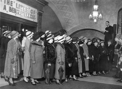 Women in hats queuing for cinema, Carlton Cinema, London, 15 may 1935.