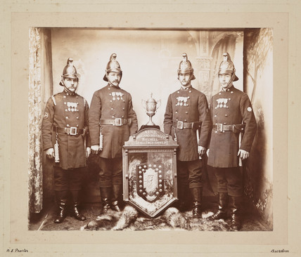 Firemen with award, late 19th-early 20th century.