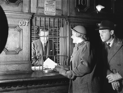 Passengers buying train tickets, 1936.