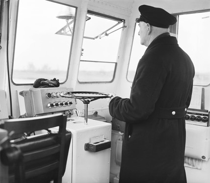 Captain at the wheel of the 'Catherine', Gravesend, 31 January 1961.