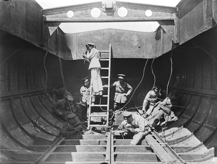 Soldiers welding together sections of a boat, 19 September 1918.