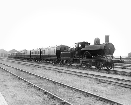 2-4-0 locomotive and train at Wolverton Works, 1893.