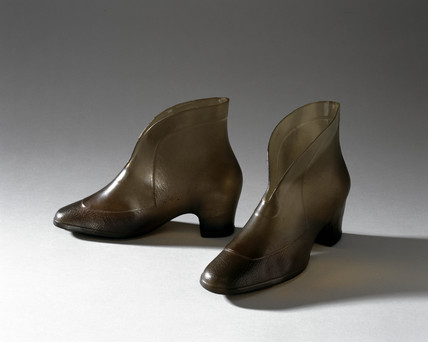 Pair of pale green women's galoshes, Canadian, c 1980s.