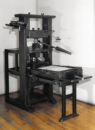 Wooden printing pres, early 18th century.