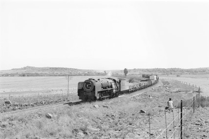 Steam locomotive and freight train, Karee, South Africa, 1968.