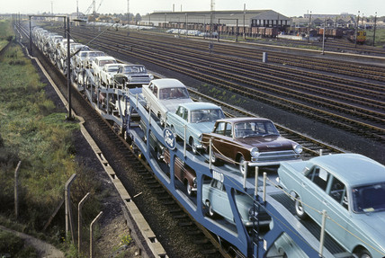 Ford cars on a freight train at Dagenham, Essex, 1965.