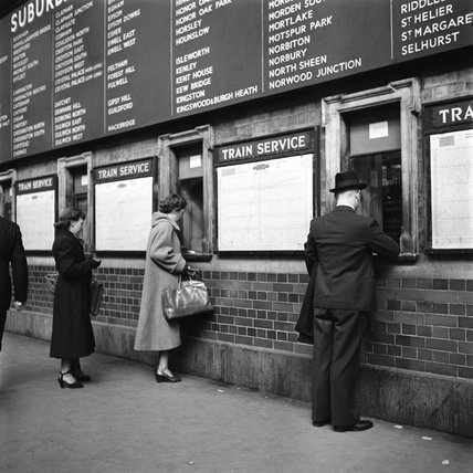 Passengers buying tickets at Victoria Station, London, 1951.