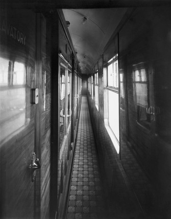 View along corridor of  railway carriage, 24 January 1936.