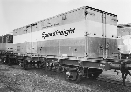 London Midland region Speedfreight container on flat wagon, c 1980s.