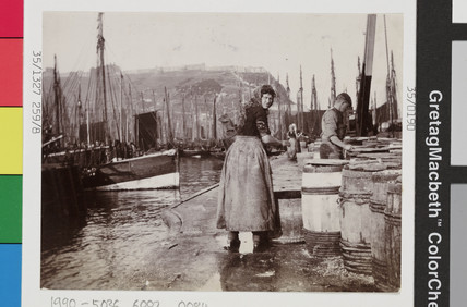 Scottish fishergirls gutting herring on Scarborough quayside, c 1900s.
