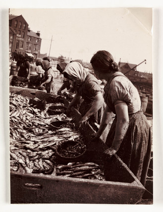 Women sorting fish, Whitby Harbour, North Yorkshire, c 1905.