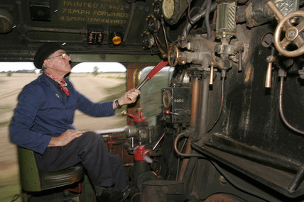 Driving the controls of the 'Flying Scotsman', 31 August 2004.