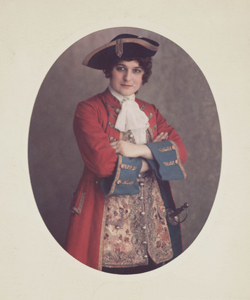 Portrait of a woman in male eighteenth century costume, c 1920.