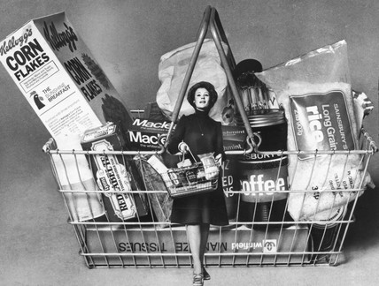 Woman and shopping basket, November 1975.