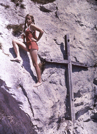Eva climbing a rock face, Lake Luzern, Switzerland, c 1927.