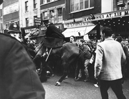 Mounted policeman and CND marchers, April 1963 or 1965.