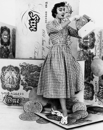 Woman with fake coins, 1950s.