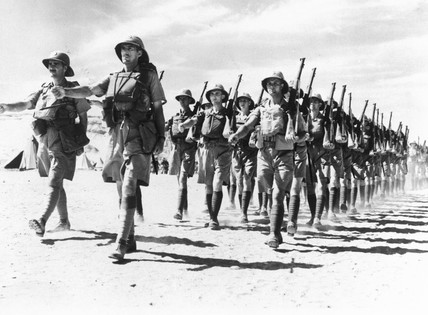 Newly arrived troops leaving  their camp for a route march, 19 November 1940.