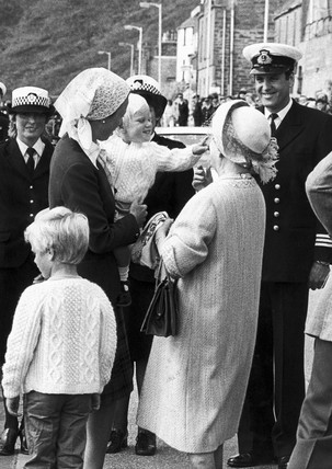 Zara Phillips tries to snatch the Queen Mother's veil, August 1983.