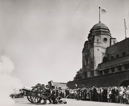 Cannon being fired outside Wembley Stadium, Olympics, 1948.