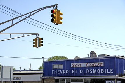 Chevrolet and Oldsmobile dealership, Jersey shore, USA, 2005.