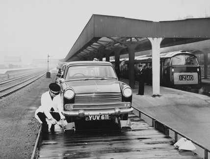 Motorail worker securing a car to a transporter, 5 April 1966.