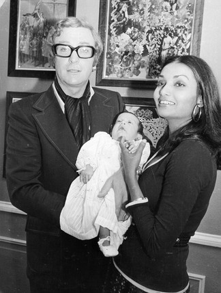 Michael Caine with wife and baby, November 1973.