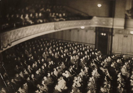 Audience photographed in infrared light, 1930s.