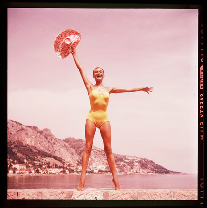 Woman in a yellow swimsuit, 1960s.