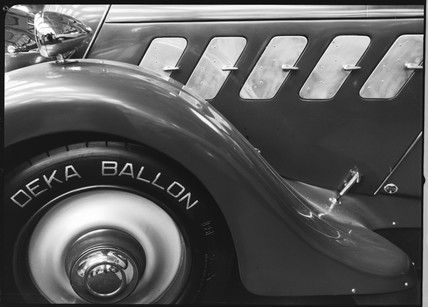 Detail of front wheel of a motor car with Deka Ballon tyre, c 1934.