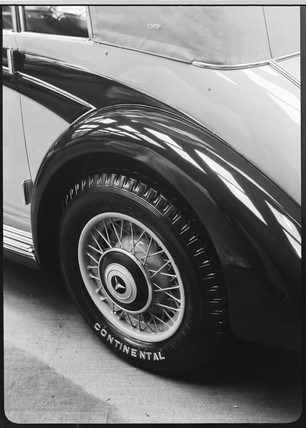 Detail of a motor car wheel with a Continental tyre, c 1934.