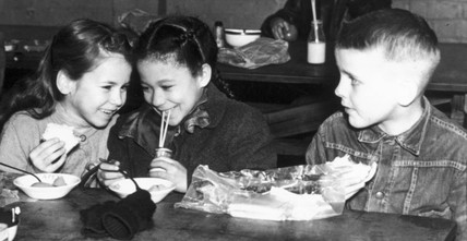 Primary school children eating lunch, 2 September 1957.