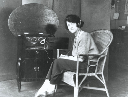 Woman listening to the wireles, c. 1920.
